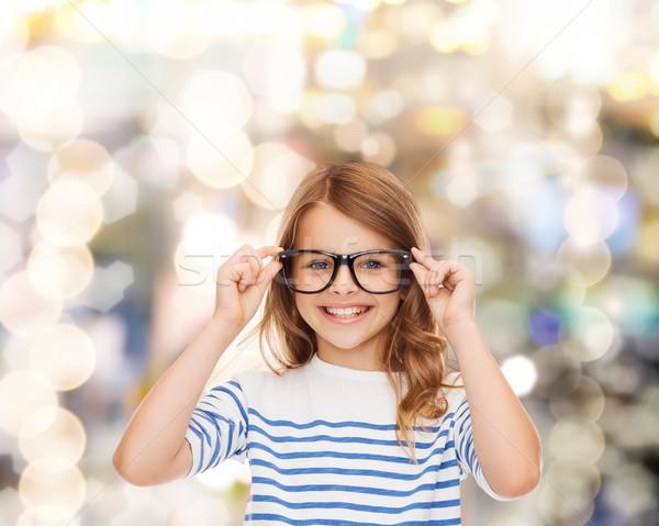 Souriant cute petite fille noir lunettes éducation Photo stock © dolgachov