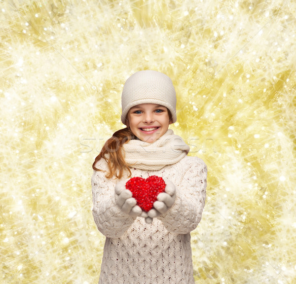 dreaming girl in winter clothes with red heart Stock photo © dolgachov