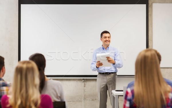 Csoport diákok tanár jegyzettömb oktatás középiskola Stock fotó © dolgachov