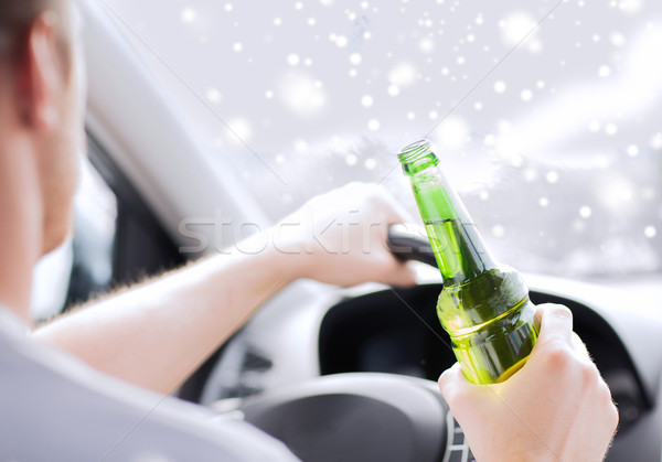 close up of man drinking alcohol while driving car Stock photo © dolgachov