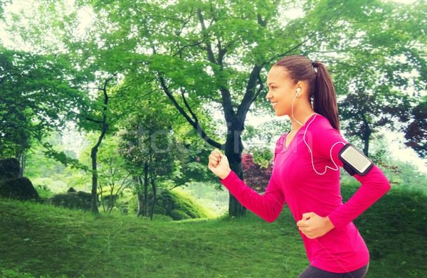smiling young woman running outdoors Stock photo © dolgachov
