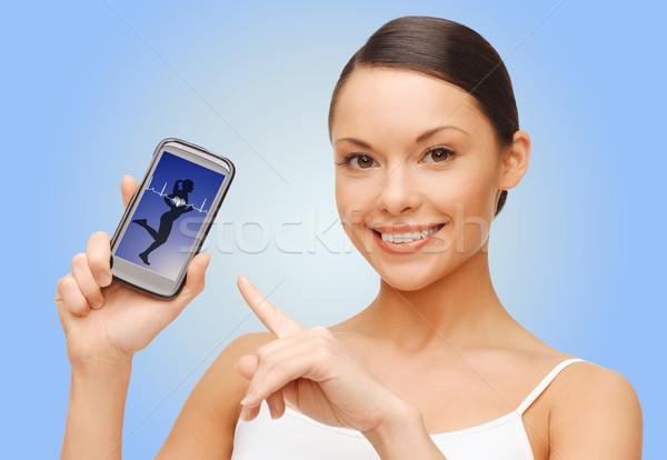 Feliz mujer Screen personas Foto stock © dolgachov