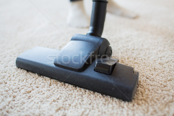 close up of vacuum cleaner cleaning carpet at home Stock photo © dolgachov