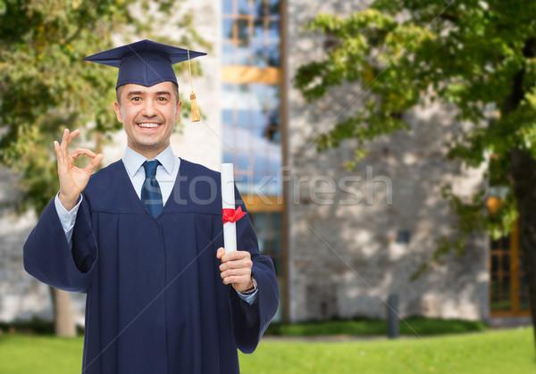 Mosolyog felnőtt diák diploma oktatás érettségi Stock fotó © dolgachov