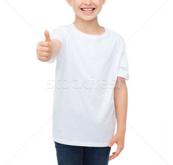 boy in blank white t-shirt showing thumbs up Stock photo © dolgachov