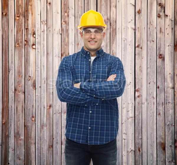 smiling male builder or manual worker in helmet Stock photo © dolgachov