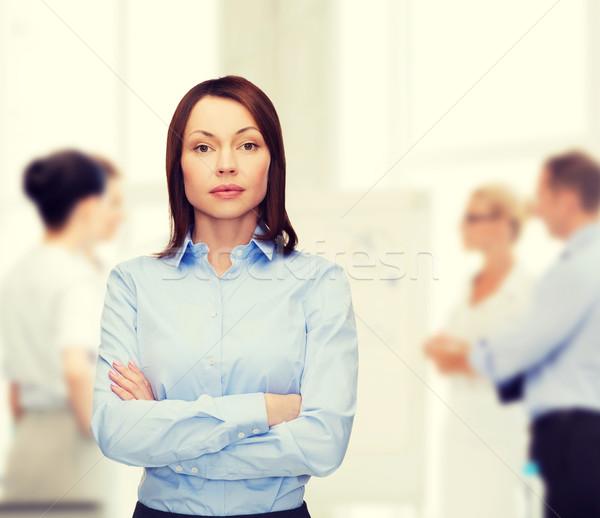 Mosolyog üzletasszony karok iroda üzlet oktatás Stock fotó © dolgachov