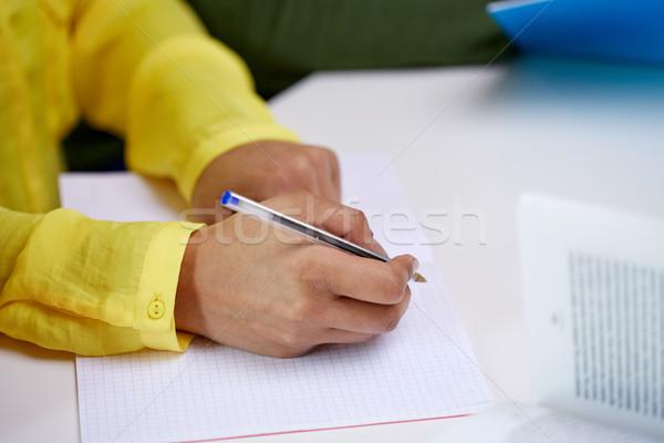 Femenino manos escrito cuaderno personas Foto stock © dolgachov