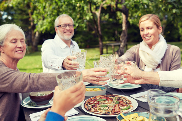 Familia feliz cena verano jardín familia generación Foto stock © dolgachov