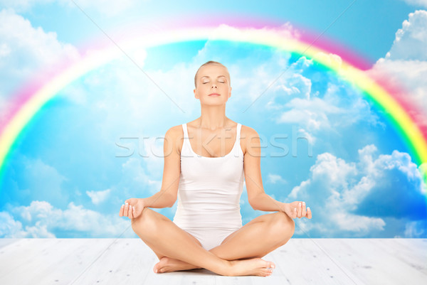 woman meditating in yoga lotus pose Stock photo © dolgachov