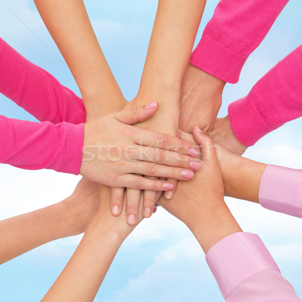 Mulheres mãos topo feminismo poder Foto stock © dolgachov
