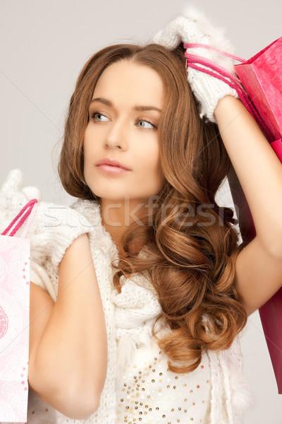 Vásárló nő bevásárlótáskák fehér lány boldog Stock fotó © dolgachov