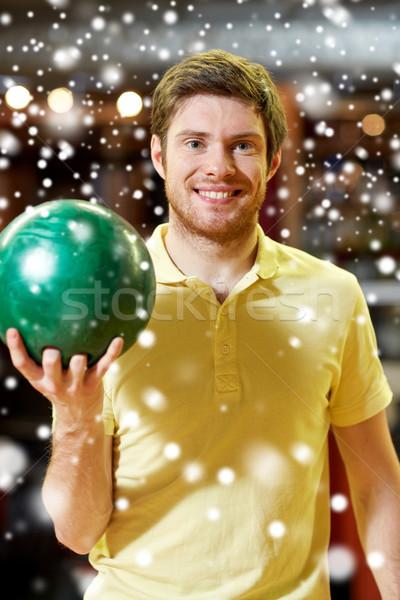 Boldog fiatalember tart labda bowling klub Stock fotó © dolgachov