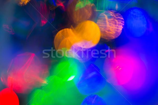 Coloré nuit lumières bokeh sombre vacances Photo stock © dolgachov