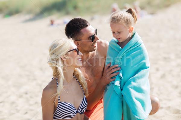 happy family on summer beach Stock photo © dolgachov
