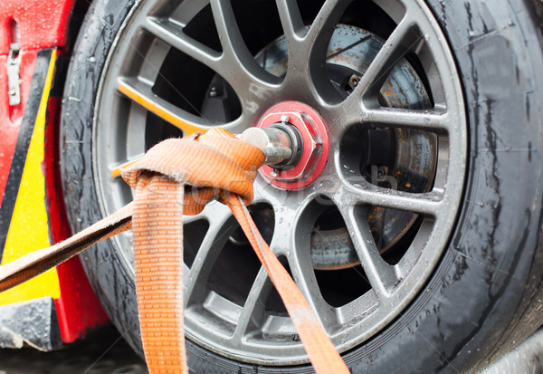 close up of race car wheel with tow rope tied to Stock photo © dolgachov