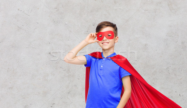 boy in red superhero cape and mask Stock photo © dolgachov
