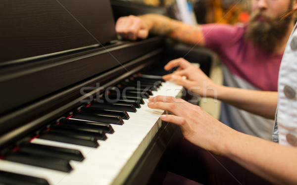 Stock photo: close up of woman hands playing piano