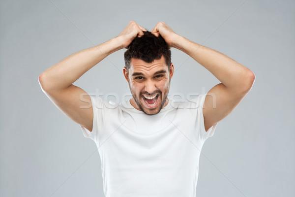 クレイジー 男 Tシャツ グレー 喜怒哀楽 ストックフォト © dolgachov