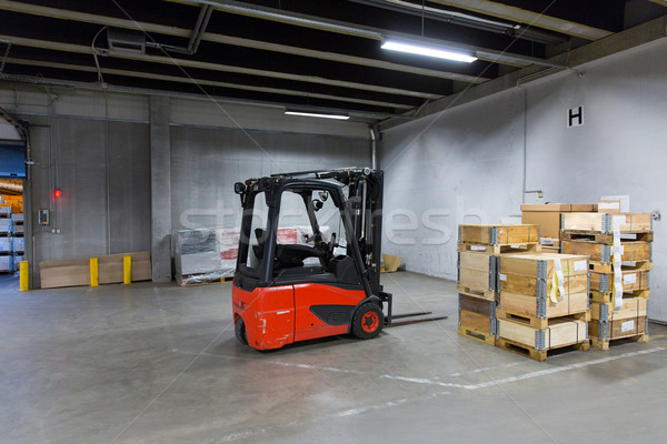 forklift loader and boxes at warehouse Stock photo © dolgachov