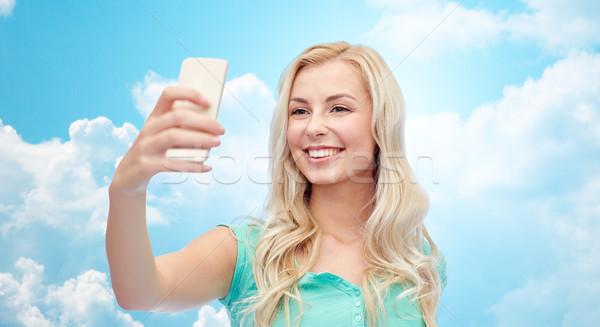 ストックフォト: 笑みを浮かべて · 若い女性 · スマートフォン · 喜怒哀楽