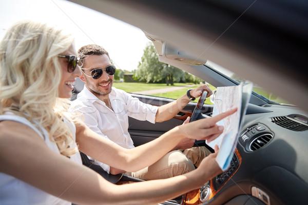 Mutlu adam kadın harita kabriyole araba Stok fotoğraf © dolgachov