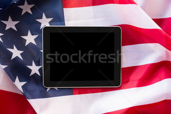 close up of tablet pc computer on american flag Stock photo © dolgachov