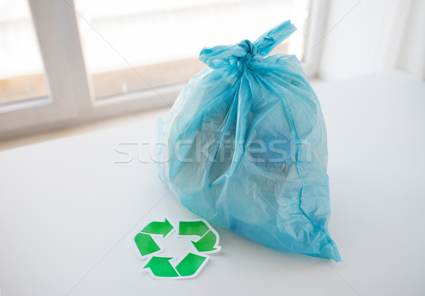 close up of rubbish bag with green recycle symbol Stock photo © dolgachov