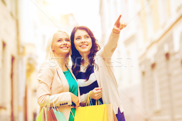 girls with shopping bags in ctiy Stock photo © dolgachov