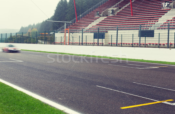 close up of car driving on speedway track or road Stock photo © dolgachov