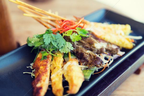 Közelkép ázsiai harapnivalók tányér konyha étel Stock fotó © dolgachov