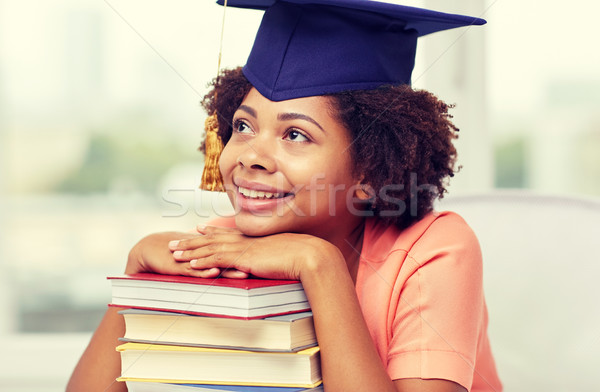 Glücklich african Bachelor Mädchen Pfund home Stock foto © dolgachov