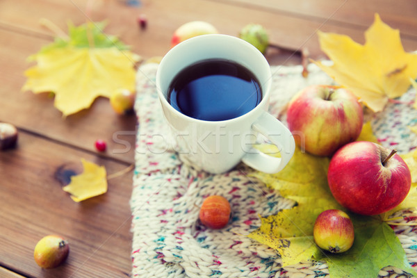 Stock photo: close up of tea cup on table with autumn leaves