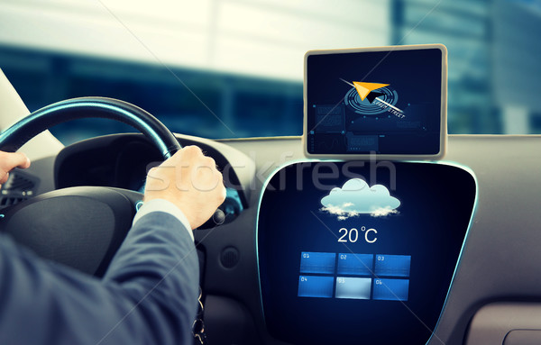close up of businessman with tablet pc driving car Stock photo © dolgachov