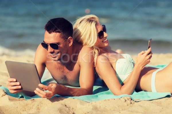 幸せ カップル 日光浴 ビーチ 愛 ストックフォト © dolgachov