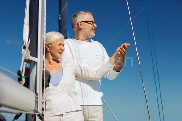 Boldog idős pár vitorla csónak jacht tenger Stock fotó © dolgachov