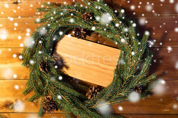 natural green fir branch wreath and wooden board Stock photo © dolgachov