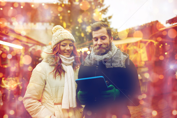 happy couple walking with tablet pc in old town Stock photo © dolgachov
