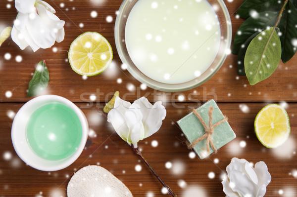 body lotion, cream and handmade soap on wood Stock photo © dolgachov