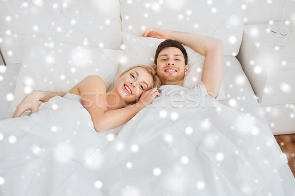 счастливым пару кровать домой люди любви Сток-фото © dolgachov