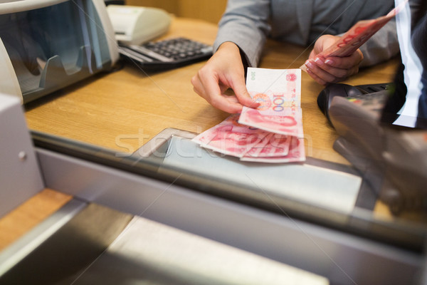 clerk counting cash money at bank office Stock photo © dolgachov