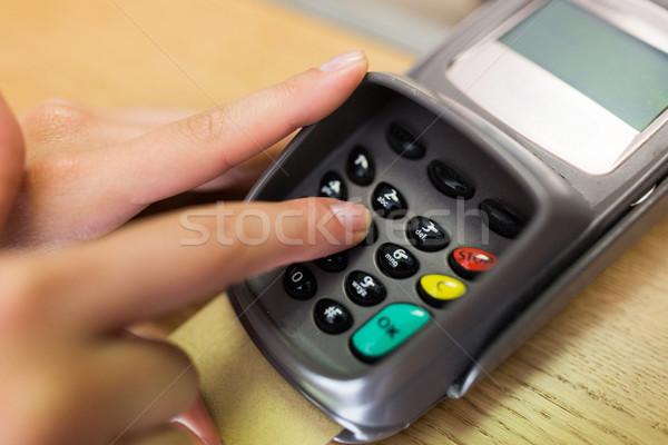 close up of hand entering code to money terminal Stock photo © dolgachov
