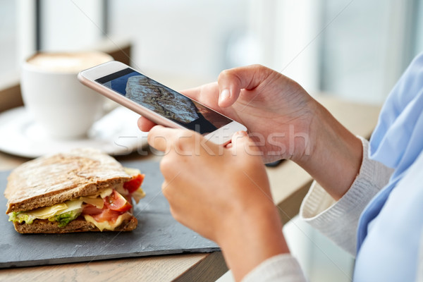 hands with smartphone photographing food Stock photo © dolgachov