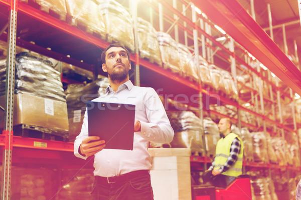 businessman with clipboard at warehouse Stock photo © dolgachov