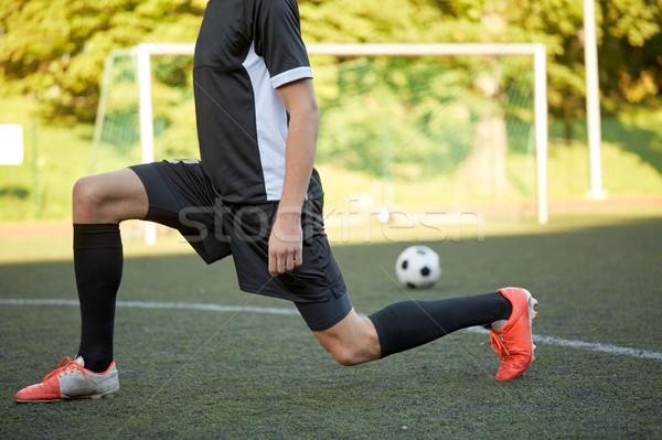 soccer player stretching leg on field football Stock photo © dolgachov