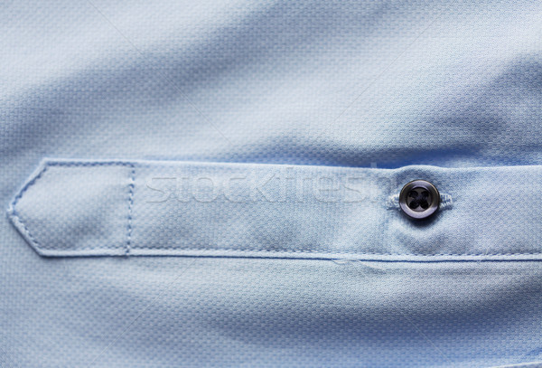 Bleu shirt douille vêtements Photo stock © dolgachov