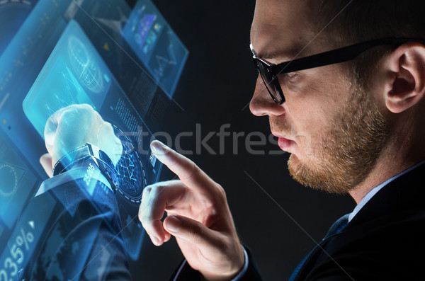 close up of businessman with smart watch Stock photo © dolgachov