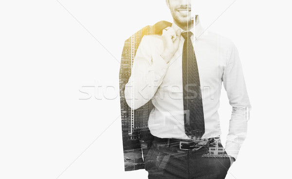 businessman with crossed arms over city buildings Stock photo © dolgachov