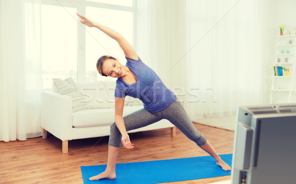 женщину йога треугольник создают фитнес Сток-фото © dolgachov