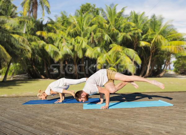 Stock photo: people making yoga exercises outdoors